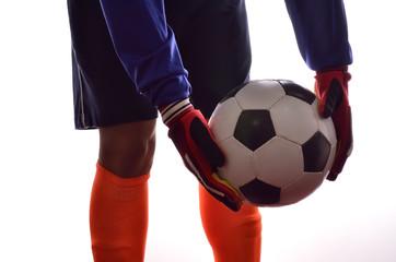 Soccer goalkeeper is taking kick in white background
