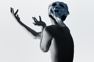 Dancing man dressed in a terrible mask