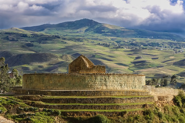 Scenic Inca ruins of Ingapirca and surrounding green andean landscape with dramatic sky, Ecuador