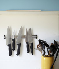 Knives on a magnetic strip in the kitchen.