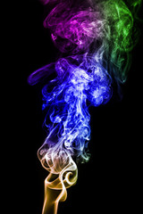 Wall Mural - colorful smoke on black background