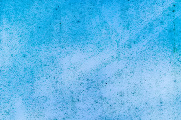 The texture of the painted wall. Blue background with dirt, dots and deffects.
