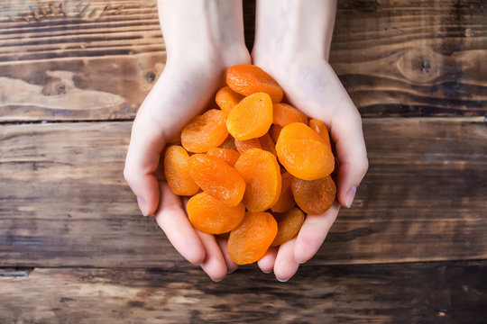 dried apricots in hands