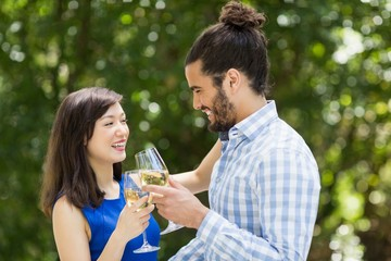 Couple toasting glasses of wine in a restaurant
