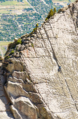 A Group Of Friends Work There Way To The Top Of The Climbing Route On Lone Peak Located In Utah's Wasatch Mountains