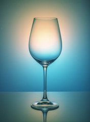 Wine glass on color background