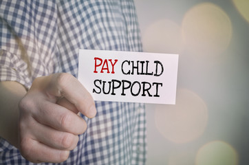 Man showing Pay child support card. Family and care concept.