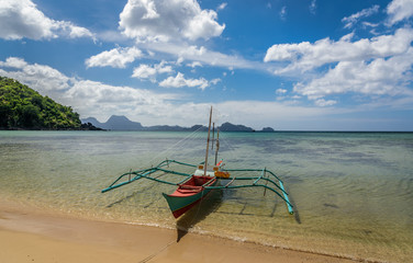 A boat on the shore of one of the Twin beaches near El Nido, Palawan, Philippines
