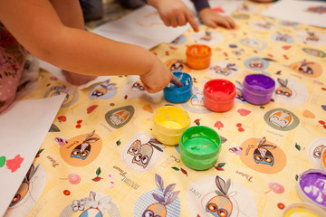 Children paint. children's hands closeup.
