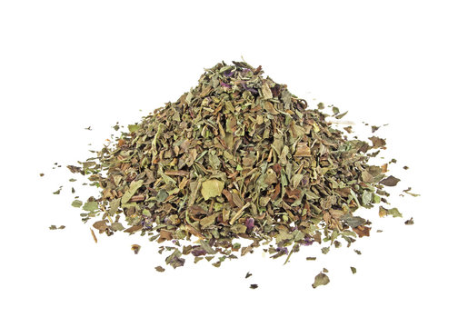 Pile of dried basil spice isolated on white background