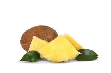 Composition of pineapple slices and coconut on white background
