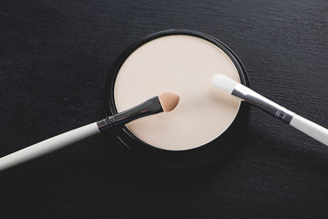 Make-up for eyes on black background. Horizontal shoot.