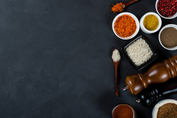 Large set of asian spices and herbs on black background