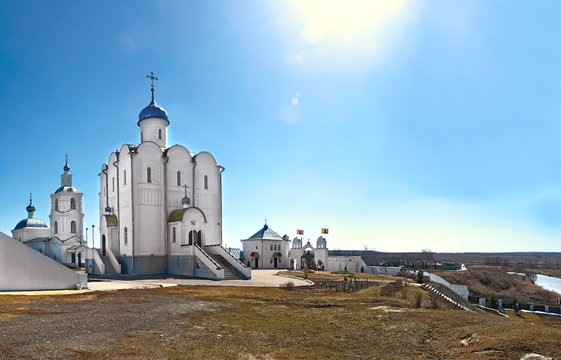 Church of Blessed Xenia of Petersburg in the village of Arskoye (Russia) and a view of the vast expanses against the background of the midday sun at the zenith in the autumn day