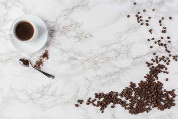 Coffee Flay Lay on Marble Background with Scattered Coffee Beans