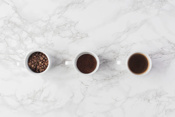 Coffee flat lays on marble and linen good for designers and small business