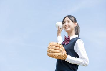 Schoolgirl Playing Baseball