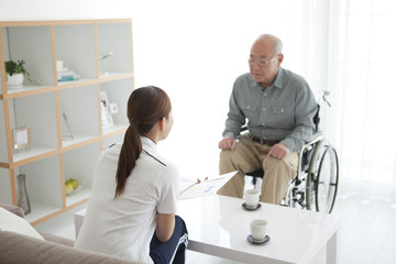 Nurse Talking To Senior Male Patient