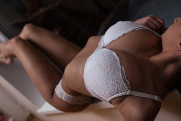 Beautiful sexy sensual young girl in lingerie underwear posing indoor