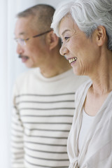 Mature couple smiling and looking away