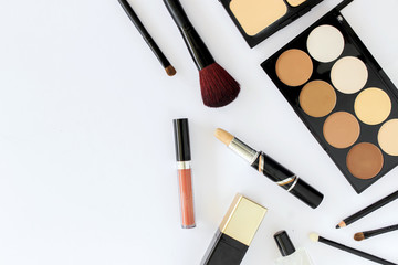 makeup cosmetics on white table background, over light, top view