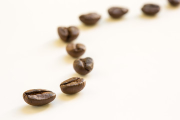 Curve of coffee bean on white background