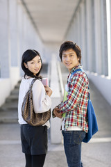 Two university students looking at camera