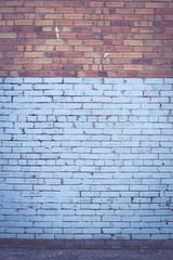 Blue and red industrial brick wall in portrait frame