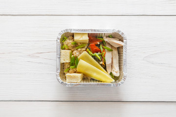 Healthy food in foil boxes, diet concept.