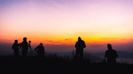 Couple of people viewing the sunrise over the mountains in National Park.