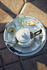 Moroccan kettle with tea on tray