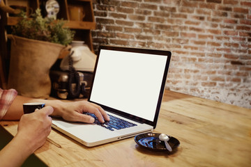 Man drinking coffee and working Blank screen laptop on table. for Product and Graphic display montage.