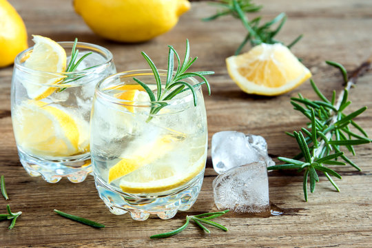 Gin Tonic Cocktail with lemon, rosemary