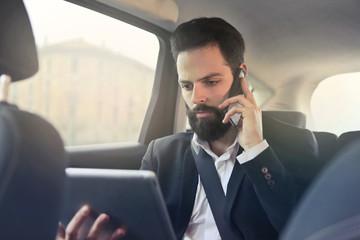 Serious businessman doing a phone call