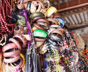 Heap of handcrafted souvenirs at flea market.