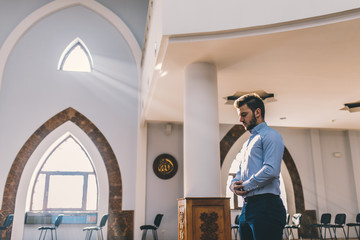Muslim praying in a building with perfect background