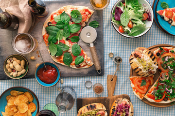 Pizza, hot dog, salad, wine, beer and snacks for beer