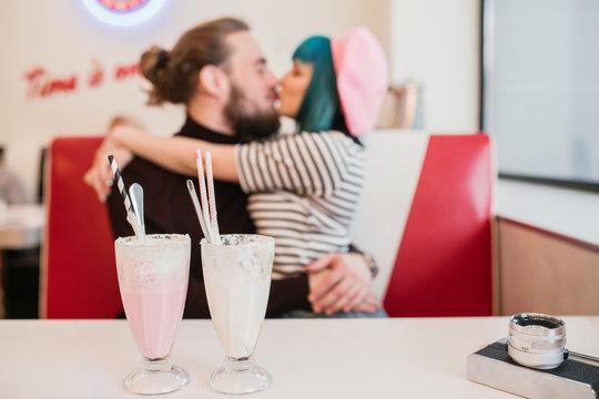 Couple Kissing at Diner Restaurant
