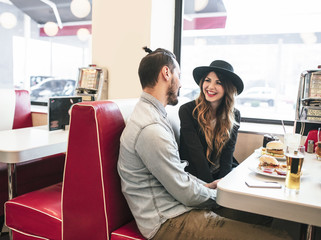 Couple in Love Chatting at Diner Restaurant