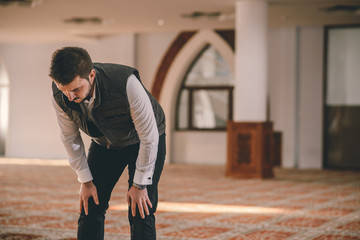 Muslim bowing humbly