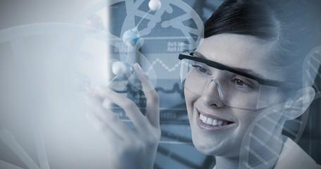 Composite image of female scientist holding molecular model