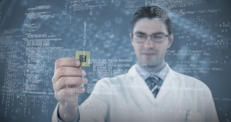 Composite image of engineer holding computer chip