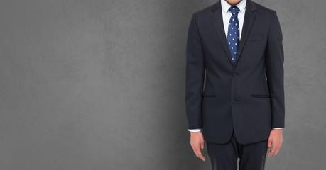 Composite image of Businessman Torso against grey background