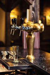 beer tap at the bar.A pub.Bar.Restaurant.Classic.Evening.European restaurant.European bar.American restaurant.American bar.strong drink