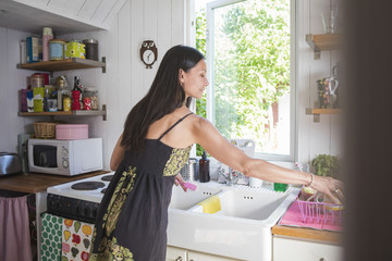 Woman working in kitchen at home