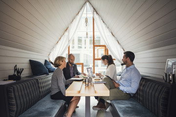 Business people discussing in meeting at table