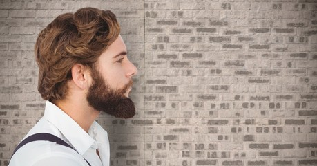 Composite image of Man with beard against brick wall
