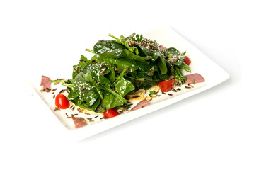 Arugula and spinach salad with tomato and cedar nuts