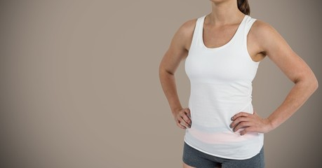 Fitness woman Torso against a neutral brown background
