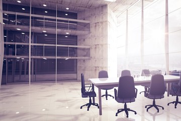 Composite image of empty office chairs and table